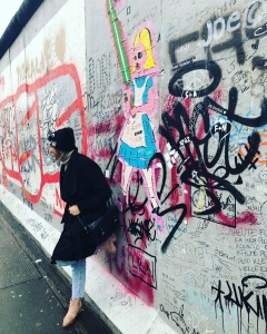 Nadya in Berlin with graffiti
